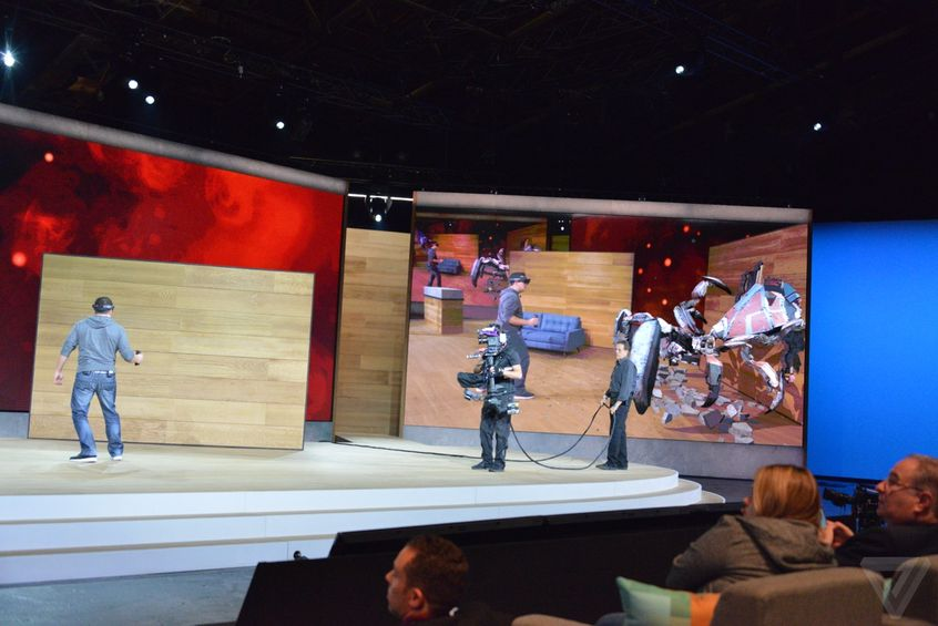 A man using HoloLens in front of audience